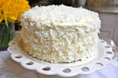 CoconutCake.  Original recipe from Ina Garten (queen of butter and cream cheese), adapted by Blue Eyed Bakers