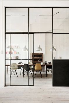 Glass partitions, maybe with electrically charged glass shading for privacy
