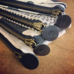 New matt gold zips with embossed leather puller just in!