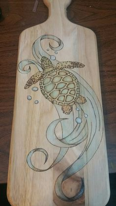 Wood burned sea turtle cutting board
