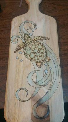 Wood burned sea turtle cutting board