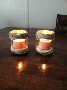 Homemade Candle Holders  Baby food jars sand hot glue twine <3