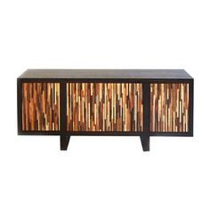 A mix of cheerful tones elevates a modest sideboard to a focal point. Rainbow by Urbia.