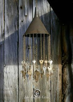 I absolutely love these key wind chime! A great addition to any garden. Wind chime made using recycled materials including tin funnel, keys, brass connectors, pocket watch cover, brass ornament, and chain. This mobile measures 7 wide and 28 long.