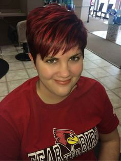 Trendy & fun short textured pixie hair cut and red Velvet color by master designer Carolyn Lasare @ Elegante salon Ogden ave naperville il ! 6304208700 appts mon tues fri sat! Aquage / Redken / Provana/ Matrix/ Surface Salon
