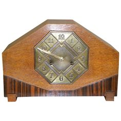 Striking Art Deco Mantle Clock with Mixed Wood and Brass Detail | From a unique collection of antique and modern clocks at https://www.1stdibs.com/furniture/decorative-objects/clocks/