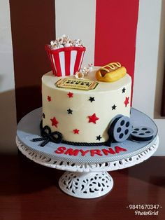 Movie theme cake For a Movie buff with Movie Ticket, Movie Reel and her favourite Popcorn and Hotdog . Cake Flavor: Chocolate truffle cake covered in buttercream with fondant accent Movie Theme Cake, Movie Cakes, Movie Themes, Chocolate Truffle Cake, Chocolate Truffles, Husband Birthday, 10th Birthday, Movie Reels, Cake Truffles