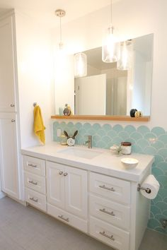 Light and airy kids' and guest bathroom, with a built in vanity step stool.