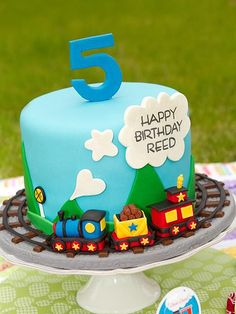 Happy Birthday, Prince George! 10 Cakes Fit For the Little Royal | ALL ABOARD | With London's greatest train stations just a stone's throw away from Kensington Palace, a locomotive-inspired cake would (quite literally) come close to home.