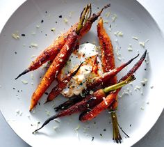 Spice-Crusted Carrots With Harissa Yogurt -  The sugar in the spice rub can burn if cooked too long, so watch these closely.