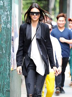 Kendall Jenner used the sidewalk as her runway, strutting her stuff in a badass tuxedo jacket and flat-top, angular square shades!