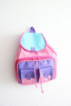 It's a pastel paradise! | The 26 Ugliest '90s Backpacks To Ever Meet Your Eyes