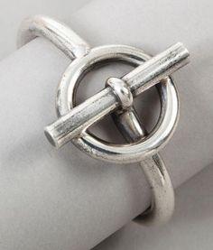 Hermès - jonc ouvrant en argent, figurant un fermoir bâtonnet