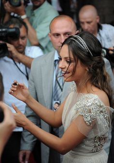 Love the chains in her hair with the romantic dress