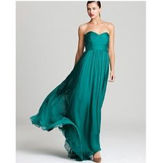 Badgley Mishka Teal Strapless Gown Badgley Mishka Teal Strapless Gown. Sweetheart neckline. NWOT. Never worn! Size 8. Purchased at Saks (I believe) for $495. Comes with a removable tie sash for the waist. Badgley Mischka Dresses Maxi
