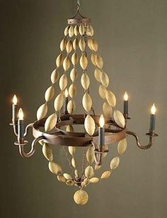 How to make a diy wood beaded chandelier beaded chandelier wood diy handmade diy make a beachy wood bead chandelier aloadofball Images
