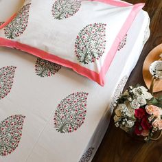 Spring Paisley Hand Block Print Bed Sheet Showcasing spring foliage in a paisley form this bedsheet evokes visions of spring. The neutral white background elevates the look of the vibrant botanical print.