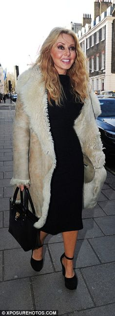 Dramatic: Carol added a full-length sheepskin coat to boost the glamour along with a pair ...