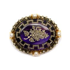 19th century amethyst, diamond and pearl brooch, French c.1860, large oval amethyst with inlaid rose diamond vine and Greek-key decoration, gold, diamond and pearl scroll border.