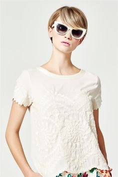 This lavishly embroidered top is one of the most versatile pieces of the collection. It is intricately detailed with ornate patterns and scalloped detail on the hem and cuffs. To maintain embroidery - dry clean only. Select a high quality drycleaner. Gentle short cycle. Low moisture. Low temperature. Do not wring/drip dry. Do not allow exposure to direct sunlight. Cool iron with care on reverse. Fabric Composition: Main: 100% Polyester
