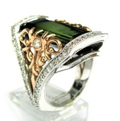 Eduardo Escudero's custom 14kt white and rose gold Ring. Ring contains 1 emerald cut green tourmaline center stone weighing 15.79ct. Also set in ring are 72 brilliant round cut diamonds weighing 1.66ct. Ring weighs 19.6 grams of 14kt white and rose gold. This is a custom made one of a kind piece.