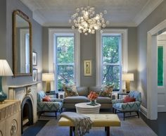 Love this living room in grey and blue with accents of chartreuse and pink.