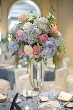 This elegant centerpiece is Made of blue hydrangea, pink peonies, white roses, hanging amaranthus, and seeded eucalyptus. Pastel perfection.