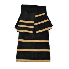 These timeless towels are great addition to your bathroom décor. The three-piece Sherry Kline decorative towels set feature a cotton bath, hand, and fingertip towel, each embellished black and gold stripes.