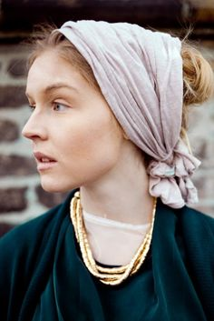 head scarf- color and a different way to tie it. Plus the picture is stunning.