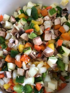 I'm trying to go lower carb.  Trying.  This was a success.  I used one of those handy flip lid chopper things to dice up:  yellow, orange, and green peppers, zucchini, mushrooms, onion, and I cut carrots and garlic by hand.  It's my breakfast mix.  From this I can make omelets, frittatas, or just eggs with sautéed veggies on the side.