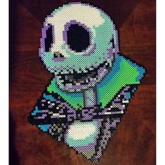 I see loads of these framed heads but I like the colours in this one. - Jack Skellington perler beads by  corpsecollecter