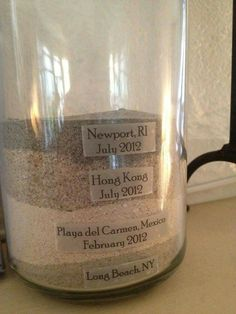 Sand Jar.....layering the sand from different places you've traveled and labeling them.