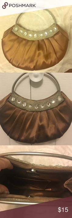 Light brown satin purse Satin purse with bead detail. Never used. No stains. Boutique purchase. Bags