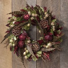 Pheasant Feather Wreath from Artisan Table on shop.CatalogSpree.com, your personal digital mall.