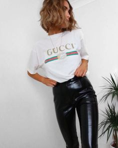 Tuck it into leather bottoms. #refinery29 http://www.refinery29.com/2016/12/134182/gucci-logo-t-shirt-trend#slide-2