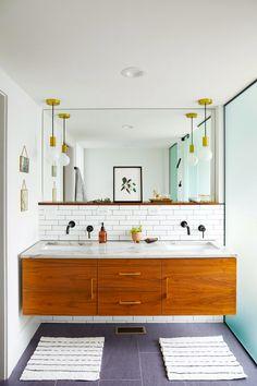 A floating vanity makes any bathroom feel airy by opening space between the bottom of the vanity and the floor. #bathroomideas #bathroomremodel #newbathroom #bathroomdecor #bhg Modern White Bathroom, Minimalist Bathroom, Contemporary Bathrooms, Beautiful Bathrooms, Small Bathroom Vanities, Vanity Bathroom, Bathroom Ideas, Bathroom Updates, Glass Bathroom