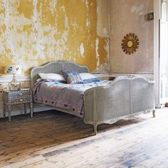 not only do i want this bed, i adore the distressed wall style