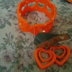 Orange Heart Earrings and Bangle Set NWT This vibrant set will compliment any Summer wardrobe! Heart fish hook earrings with heart cut puts bangle. Jewelry Earrings