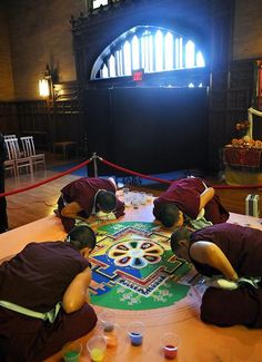 A group of Tibetan Buddhist nuns continue work on a sand mandala in the chapel at Wellesley College's Houghton Chapel 10/25/12.  Ken McGagh/for Daily News and Wicked Local