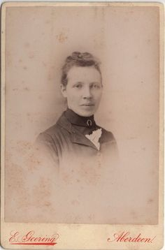 Cabinet Photo of a victorian girl taken in Aberdeen, Scotland around 1890s by E. Geering (late of G. W. Wilson) at his studio located at 416 Union Street.