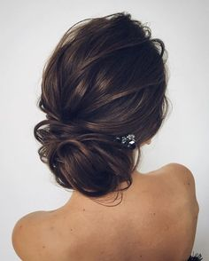 Loose bun for wedding.