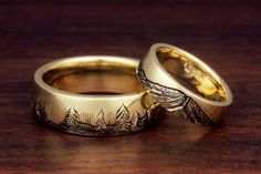 These gorgeous mountain wedding rings are handcrafted by our master goldsmiths, with the mountain range and imagery that you desire! The bands pictured were done in 18k yellow gold and depict Mt. Rainier and forest trees.