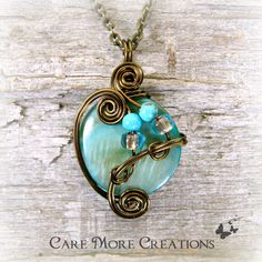 Cyan Mop Shell Wire Wrapped Pendant Necklace by CareMoreCreations.com, $25.00