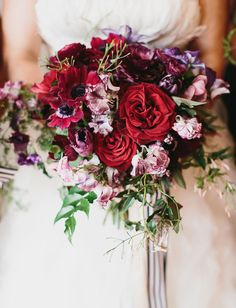 deep red bouquet anemone + rose with cascading striped ribbon
