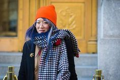 Huge scarf? Cozy beanie? No problem. We've rounded up the best street style inspiration for how women styled their hair while dealing with warm winter accessories - click to see!