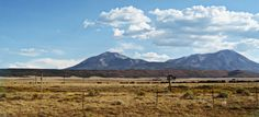 old wooden windmill & the Spanish Peaks