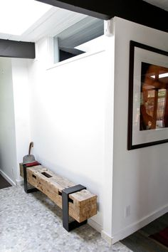 This is a beautiful rough-hewn bench that anchors the modern space. From the always inspiring @apttherapy