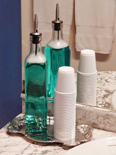 Hate the look of bulky mouthwash bottles? Transfer it into a glass oil bottle with a spout for easy and controlled pouring.
