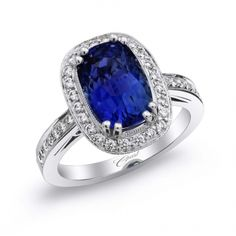This #classic #ring from our Signature Color Collection features a magnificent 6.15CT cushion-shaped #sapphire delicately trimmed with pave-set #diamonds. (LRK0100-S) #coastdiamond #jewelry #style