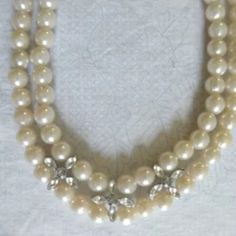 Vintage Faux Pearl Necklace Rhinestone Accents Vintage Faux Pearl Two Strand Necklace With Rhinestone Accents  It is in gently used, overall good clean condition. 